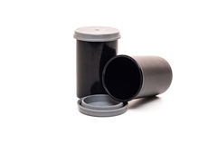 Standard film canister. All on white background royalty free stock photo
