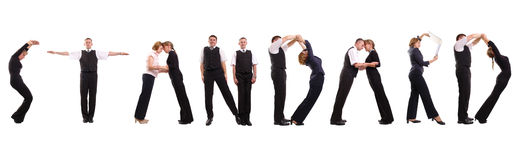 Standard group. Group of young business people standing over white forming STANDARD word stock photography
