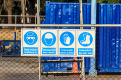 Standard hazard symbols in factory. Construction related mandatory and hazards icons and signs stock photo