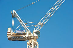 Standard life investments. Sophisticated crane on an Edinburgh building site near Princes Street with text on a sign in white letters saying ' Stand Life Royalty Free Stock Photography