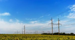 Standard overhead power line transmission tower on a sky background.  Stock Images