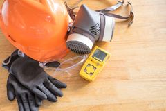 Standard personal protective equipment on wooden table. Top view, concept safety royalty free stock photos