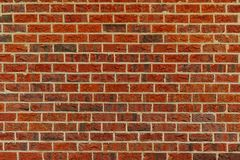 A standard red brick wall stock photo