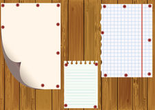 Standard sheets against wooden boards. Stock Photo
