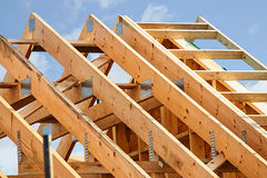 Standard timber frame roof structure. Standard timber framed building with close up on the roof trusses Royalty Free Stock Photo