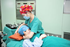 Standard to help patients to raise your head. In July 27, 2012, in a modern hospital in Jiangxi Province, to help elevate the head nurses in operation room stock image