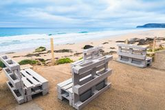 Standard white wooden furniture on a beach Royalty Free Stock Images