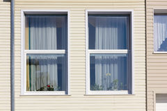 Standard windows  in mass plastic house Stock Photos