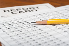 Standardized test with pencil and report card royalty free stock image