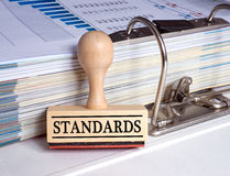 Standards stamp with binder Royalty Free Stock Photo