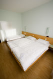 Standart interior of the hotel. With three bed (front stock images