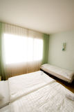 Standart interior of the hotel. With three bed royalty free stock image