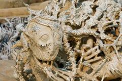 Standbeeld van duivels in hel. Stock Afbeeldingen