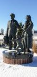 Standbeeld van immigranten in park Stock Foto