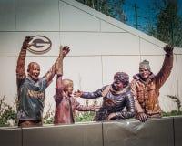 Standbeelden buiten Lambeau-Gebied Stock Foto