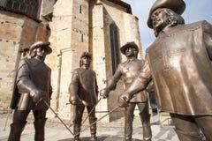 Standbeelden van D'Artagnan en de drie musketiers. Stock Afbeelding