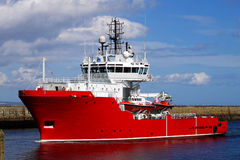 Standby boat A. Offshore Standby and Rescue boat entering port Stock Photo