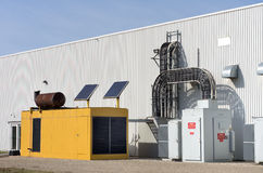 Standby Generator. A large industrial standby generator next to an industrial building Royalty Free Stock Photo