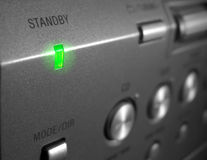 Standby LED on Electronic Device. Symbol for Energy Wastage Royalty Free Stock Images