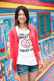 Standing. A smiling Asian girl with colorful background Stock Images
