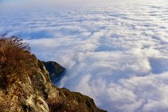 Standing above the thick clouds stock photos