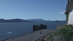 Standing on Alcatraz Island looking at San Francisco landscape stock video footage