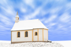 Standing alone detached building of snow-covered small chapel Royalty Free Stock Images