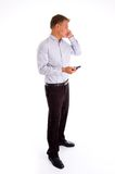 Standing american man talking on cell phone Stock Photos