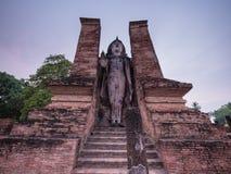 Standing ancient Sukhothai Buddha at dusk Royalty Free Stock Photo