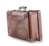 Standing at an angle battered old suitcase Stock Photography