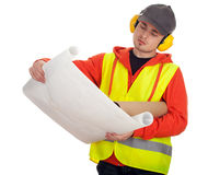 Standing architect or manual worker with blueprint Stock Photo