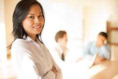 Standing Asian Businesswoman Arms Crossed Stock Images