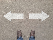 Standing At The Crossroad Making Decision Which Way To Go Royalty Free Stock Images