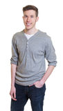 Standing australian guy in a grey shirt Stock Images