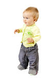 Standing baby. In jeans and shirt Stock Photo