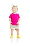 Standing baby girl in tshirt isolated Royalty Free Stock Photo