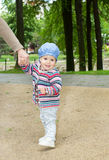 Standing baby in the park Stock Photos