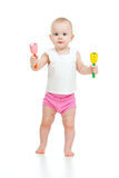 Standing baby playing with musical toy Stock Photography
