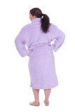 Standing back fat woman in bathrobe Stock Photos