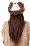 Standing back long hair woman in fur coat and hat Royalty Free Stock Photo