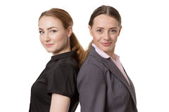 Standing backs together. Two business models standing with their backs together. Isolated on white stock photos