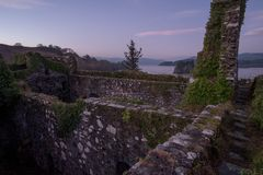 Daybreak on castle ruins. Standing on the battlements of Innis Chonnell castle on Loch Awe Royalty Free Stock Image