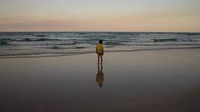 Standing on the beach stock photos