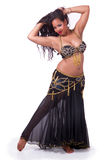 Standing bellydancer holding her hair Stock Images