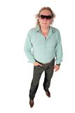 Standing big fat curly man in sunglasses. On white Royalty Free Stock Image