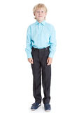 Standing blond boy wearing blue shirt looking at camera, full length, isolated white background Royalty Free Stock Photos