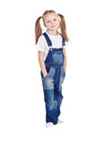 Standing blond little girl with ponytails Stock Photography