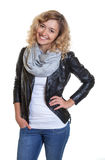 Standing blond woman in a leather jacket Royalty Free Stock Image