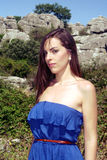 Standing in blue.- Variation 1. The model is standing in a blue dress in a mountain area Stock Photos