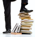 Standing on book stack Royalty Free Stock Images